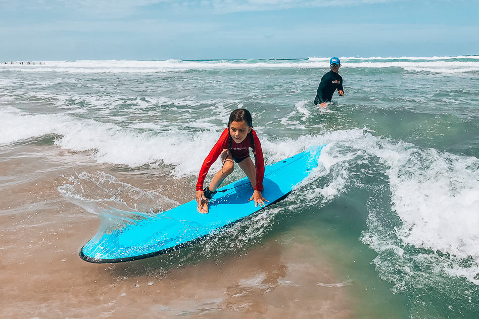 Go Ride A Wave Family Surfing Lesson Standing Up Kid