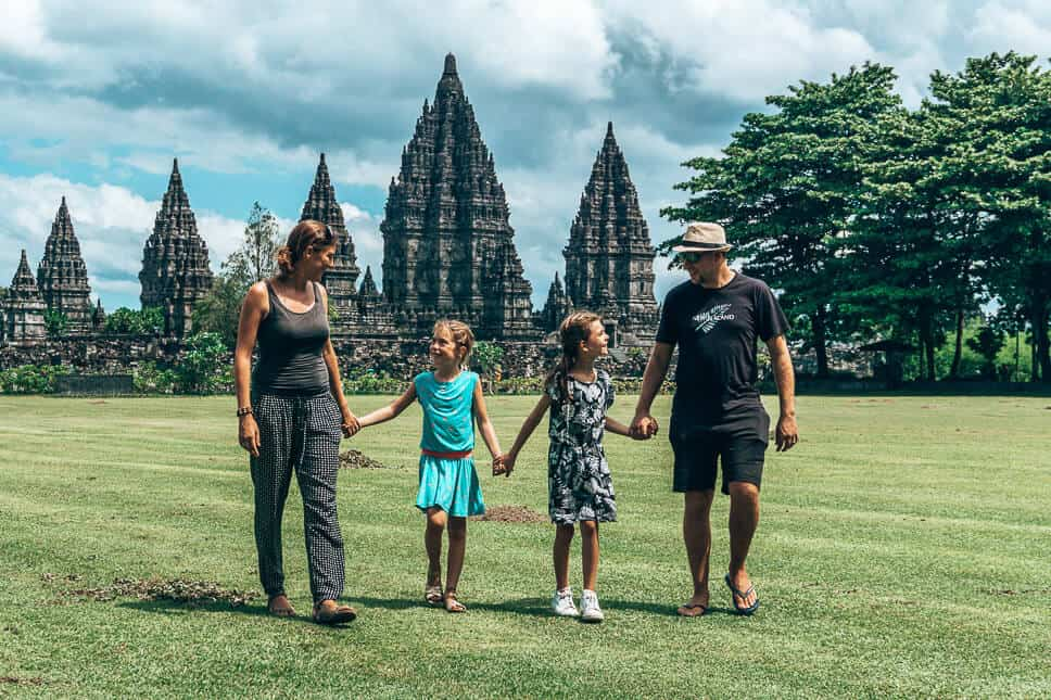 Family walking in front of the Prambanan temples on Java