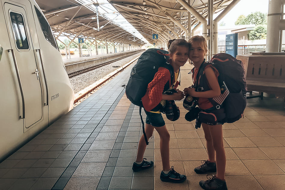 Kids with their luggage at Ipoh train station in Malaysia