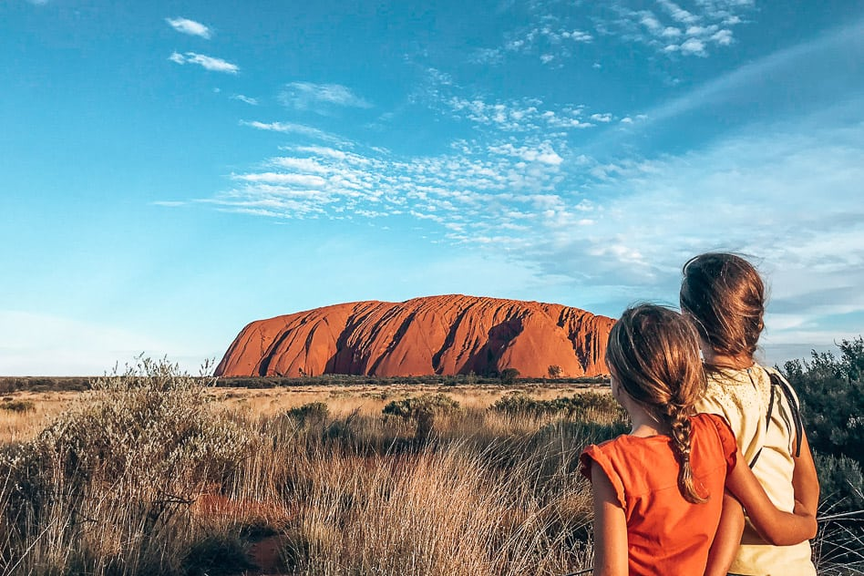 Sunset by Uluru or Ayers Rock with kids in the Outback of Australia